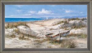 Boats and ganivelles in the sand